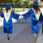 grads-holding-hands-mobile